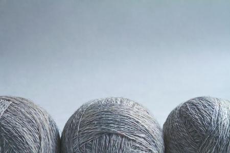 craft background: Three balls of wool, tinted craft background. Stock Photo