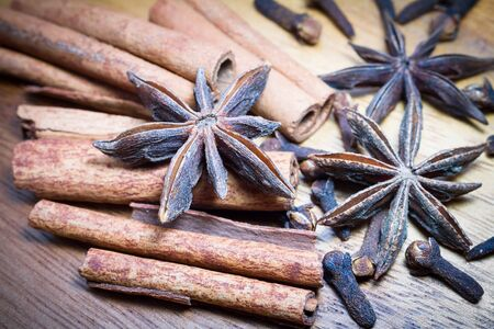 anis: Spices. Star anis and cinnamon in a stack. Tinted image.