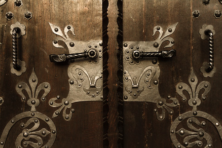 medieval blacksmith: Wooden gate and handles with metal ornamentals.