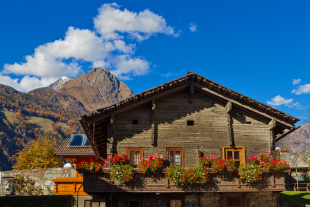locality: East Tirol in autumn.  Chalet ornated with flowers, Lienz town locality, Austria.