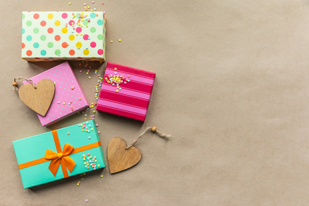 Holidays giftboxes on the craft paper background for  mothers day, christmas, birthday Stok Fotoğraf