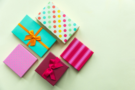 Holidays giftboxes on the pastel yellow background for  mothers day, christmas, birthday Stok Fotoğraf