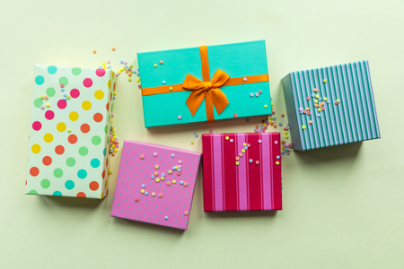 Holidays giftboxes on the pastel yellow background for