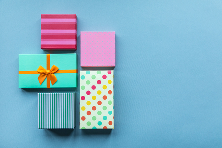 Holidays giftboxes on the pastel blue background for mothers day, christmas, birthday Stok Fotoğraf