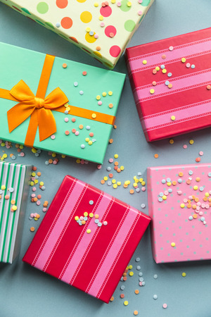 Holidays giftboxes on the pastel mint background for mothers day, christmas, birthday