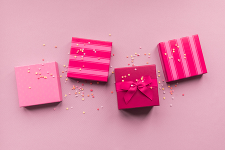 Holidays giftboxes on the pastel pink background for mothers day, christmas, birthday