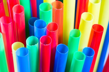 rainbow cocktail: colorful straws on a white background