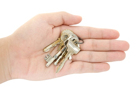secrete: The string of keys on the openning hand isolated picture Stock Photo