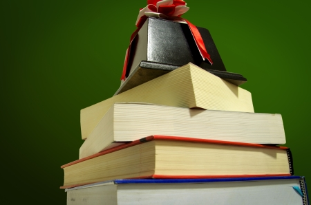 The prize on a pile of books on green background photo