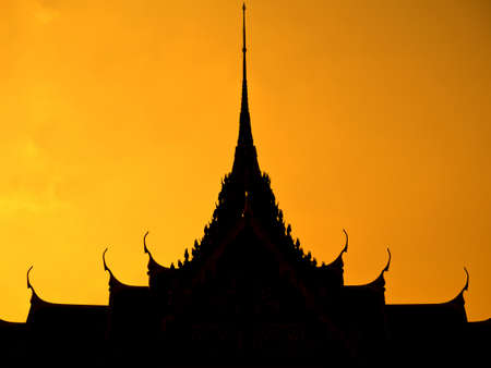 Thai multiple roof tiers  in silhouette style photo