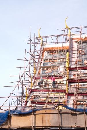 Old thai multiple roof tiers restore