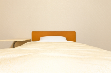 bedchamber: The clean bed inside the cool tone bedroom
