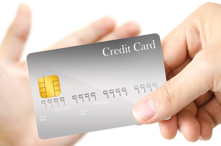 grasp: One hand grasp the blank template gray credit card and send to another one open hand as real trading situation on white background Stock Photo