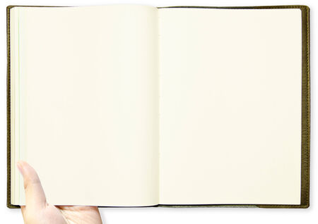 grasp: The top view of couple blank page of open brown notebook on white background with real human hand grasp at the corner as change the notebook page