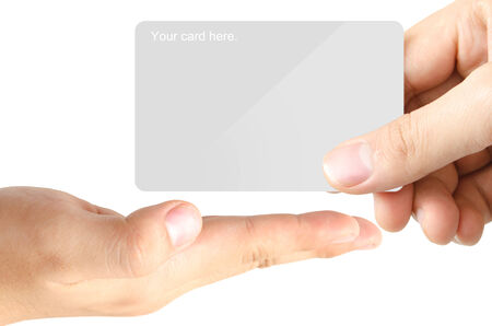 grasp: One hand grasp the blank template card and send to another one open hand on white background for designer or creative user Stock Photo