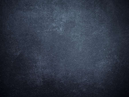 Old Scratched and Chapped Painted Dark Blue and Black Wall. Abstract Painted Dark Blue Wall Background