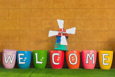 hanged: Welcoming and greetings concept with welcome word and sign on colorful hanged tags Stock Photo