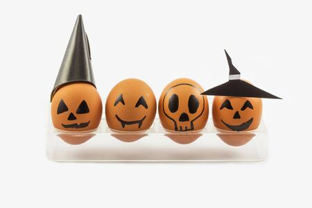 cup four: Four halloween egg in egg cup on white Stock Photo