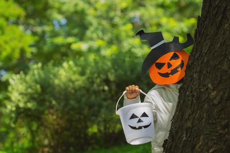 Poor kids play Halloween with the mask handmade Stock Photo