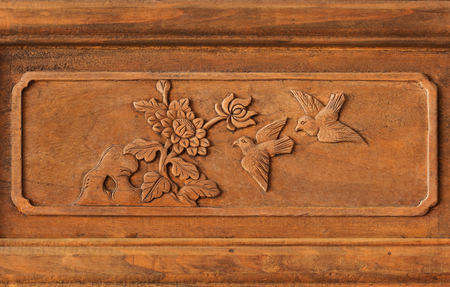 wood carvings: Wood carvings of birds for background carvings typical. Stock Photo