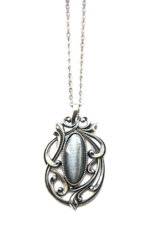 Silver pendant with big gem isolated over white photo