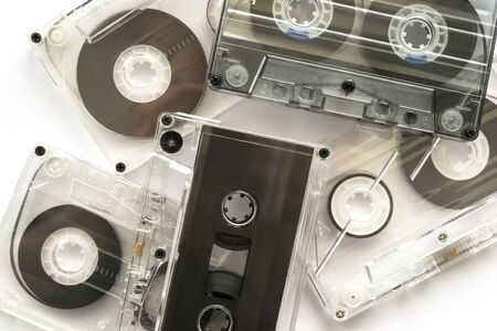 Five old audiotapes background photo