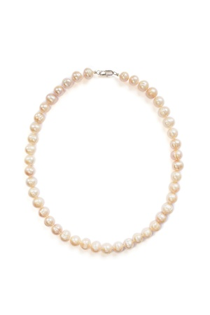 Pink pearl necklace isolated over white photo