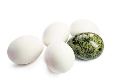 nephritis: Four white eggs and one greenstone egg isolated over white
