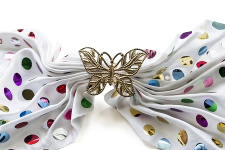 White silk kerchief decorated with multicolor paillettes and golden barrette butterfly photo