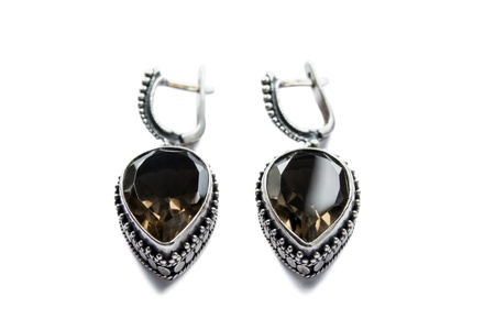 Vintage silver earrings with big faceted morion isolated over white photo