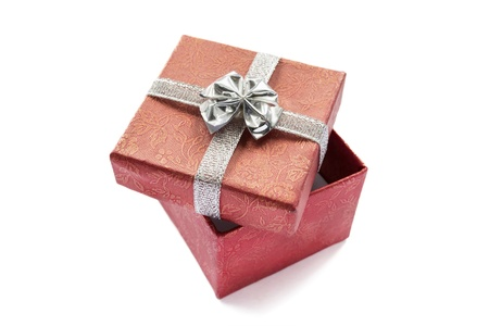 Half-opened red gift box with silver bow isolated over white photo