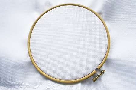 circular frame: Blank white canvas on the wooden hoop