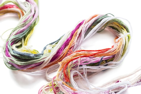 Bundle of multicolor thread isolated on white background photo