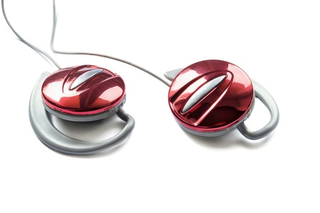 Red glossy earphones isolated on white background closeup photo