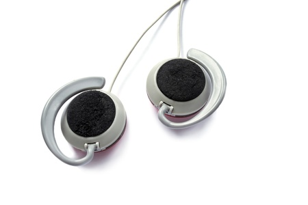 Gray plastic earphones isolated on white background photo
