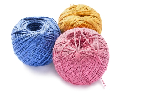 Group of three balls of cotton yarn isolated over white photo