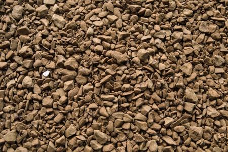 granules: Brown granules of instant coffee closeup