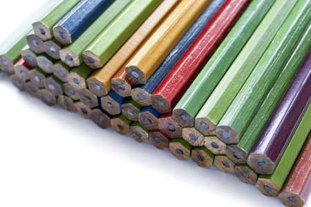 Group of multicolor unsharpened pencils closeup on white background photo