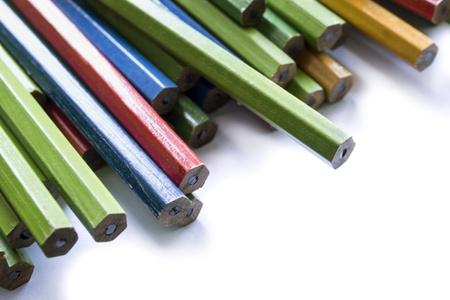 Set of multicolor unsharpened pencils closeup on white background photo