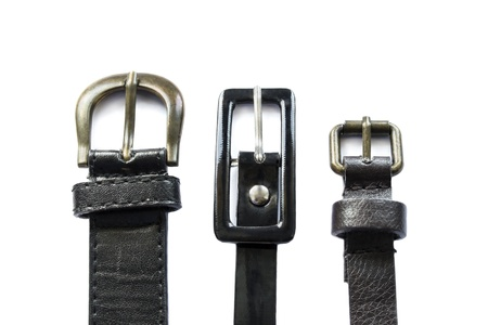 Group of three leather belts isolated on white background photo