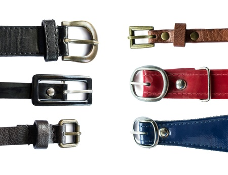 Set of six different leather belts isolated on white background photo
