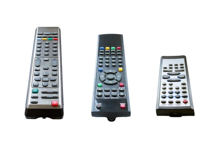 remotes: Set of three TV remotes isolated on white background