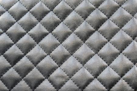 Pelle nera cucita come sfondo Archivio Fotografico - 21946761