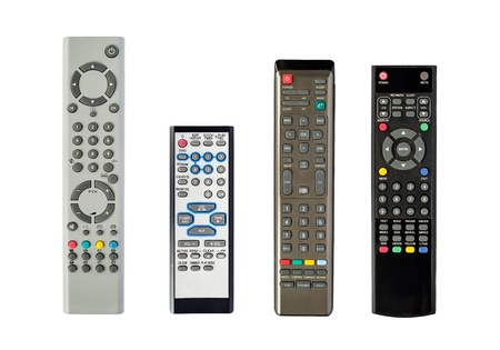 Set of four TV remote controls isolated over white background photo