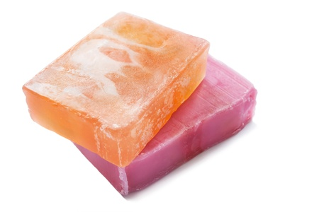 Two pieces of natural fruit soap on white background photo