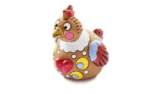 Ceramic painted statuette of chicken isolated over white background photo