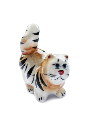 Ceramic enamelled statuette of tabby cat on white background photo