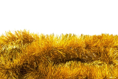frippery: Garlands of golden tinsel over white as a background Stock Photo