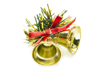 Two golden christmas bells with red silk bow on white background photo
