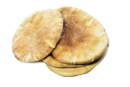 pone: Pile of four flatbread on white background Stock Photo